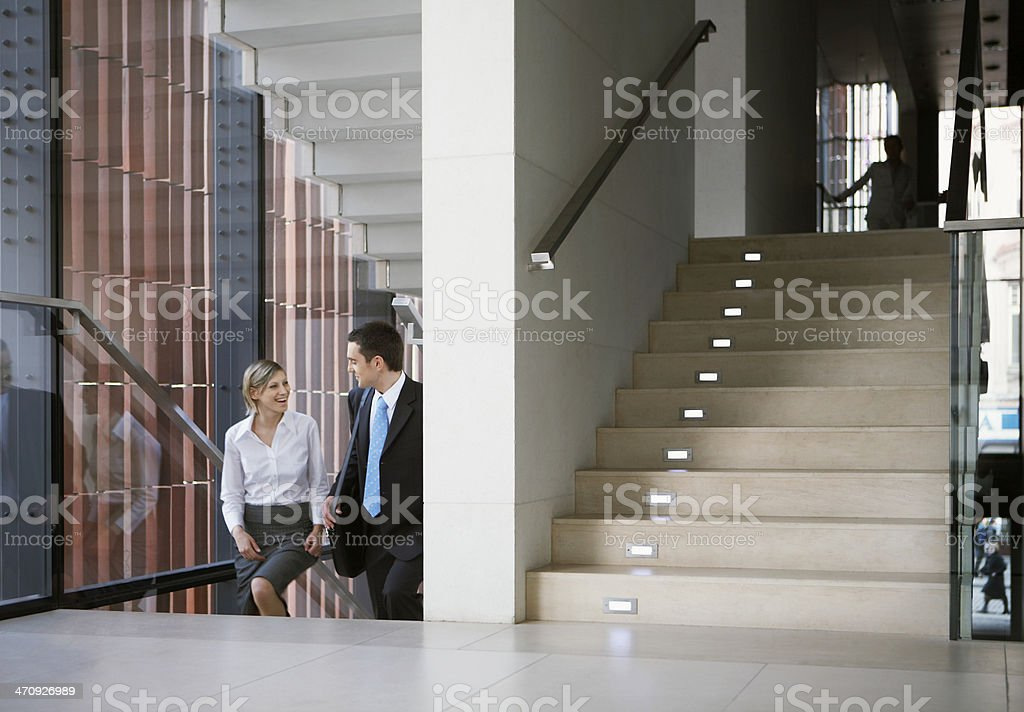 Business people in office staircase stock photo