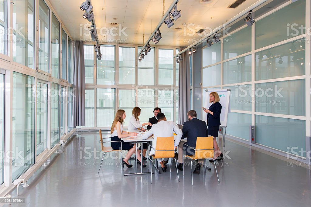 Business people in office talking about their problems,using laptops stock photo