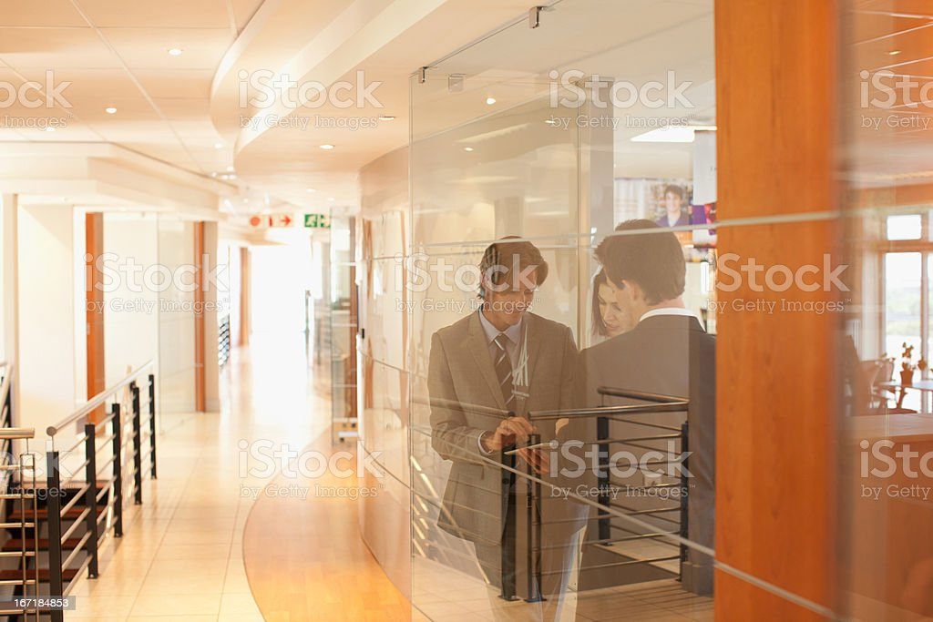 Business people in office window stock photo