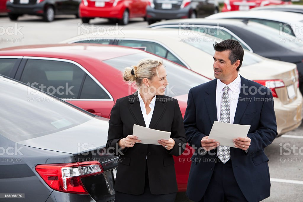 Business people in parking lot. royalty-free stock photo