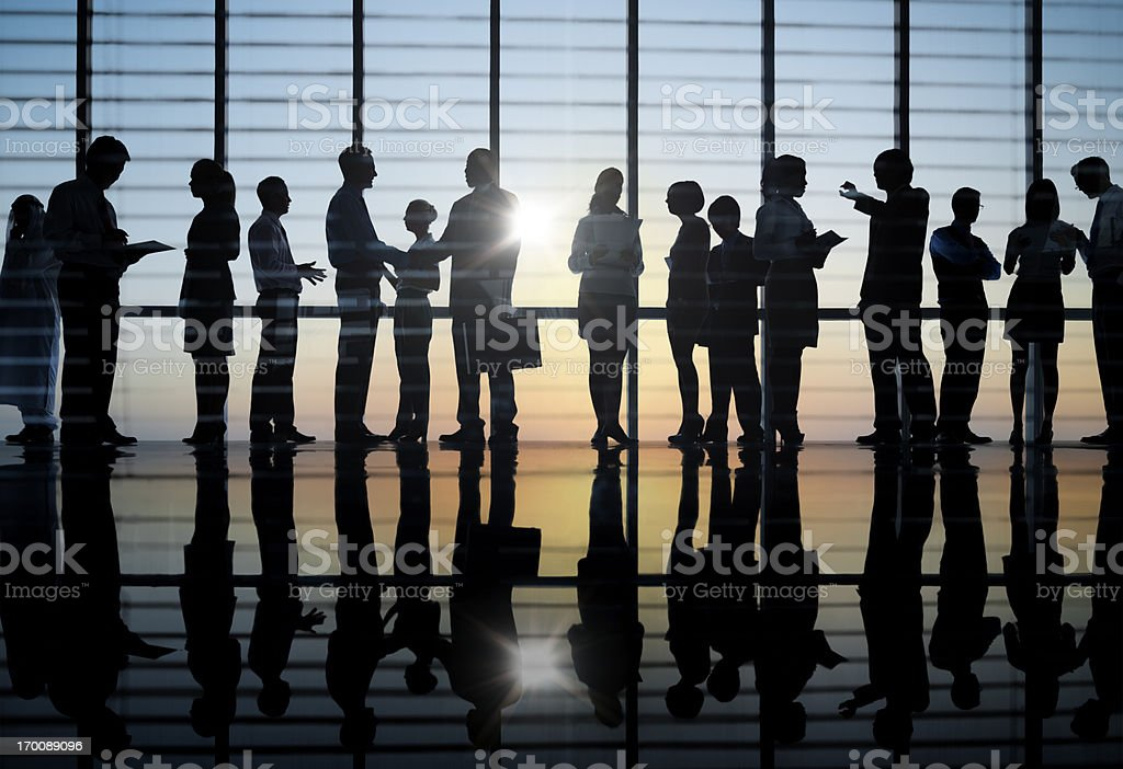 Business people in silhouette on sunset backdrop royalty-free stock photo