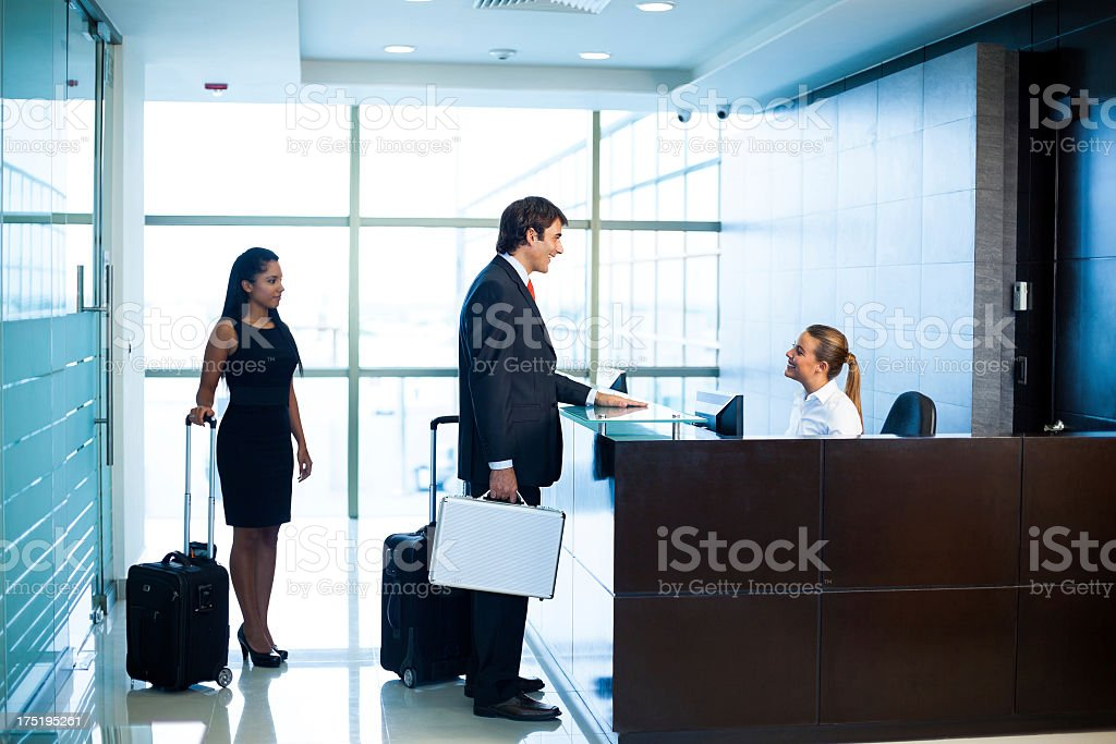 Business people in the hotel lobby stock photo