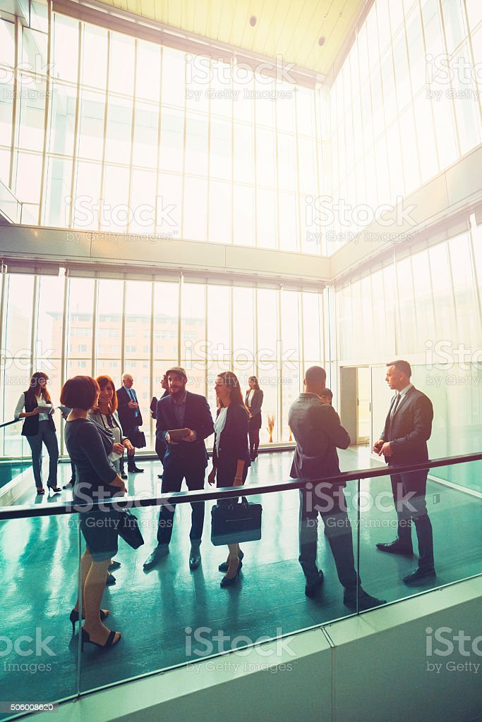 Business people in the office lobby, hipster stock photo