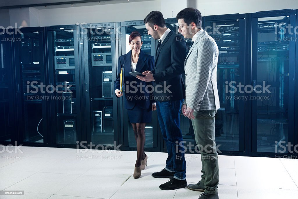 Business people in the server room checking systems royalty-free stock photo