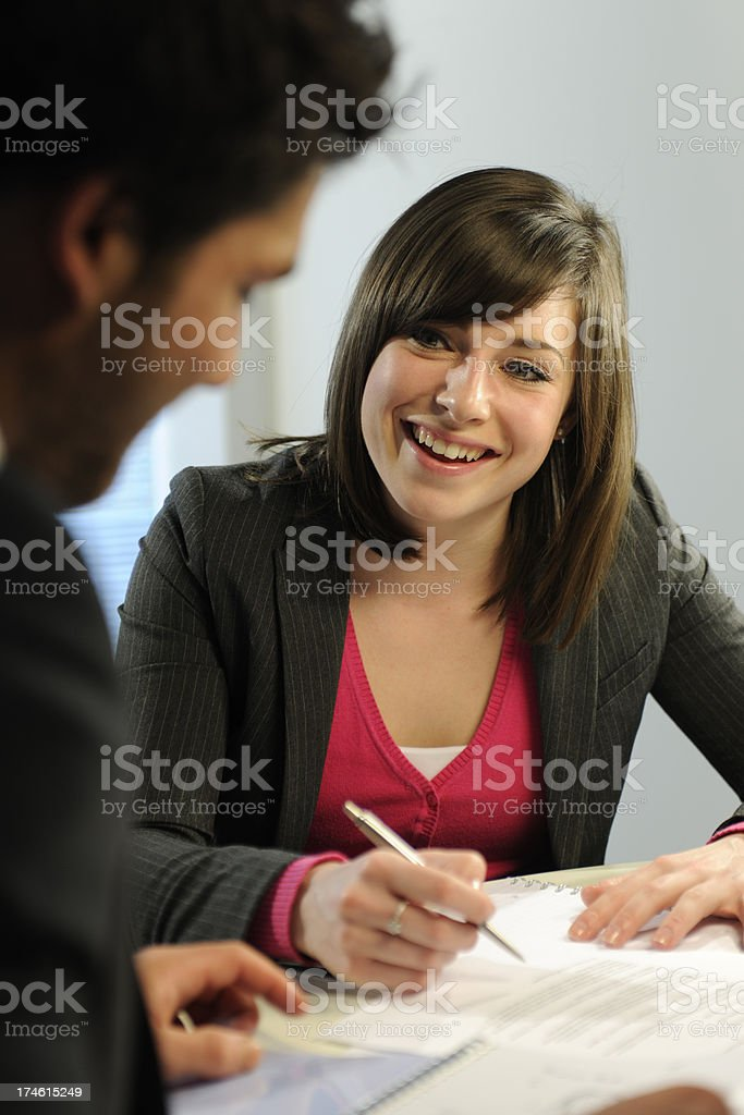 Business people interacting with paper and pens. royalty-free stock photo