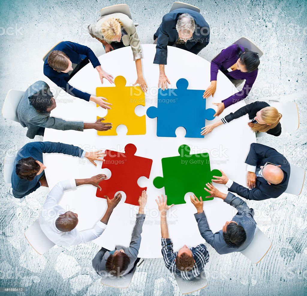 Business People Jigsaw Puzzle Collaboration Team Concept stock photo