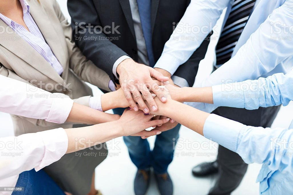 Business people joining hands in circle stock photo