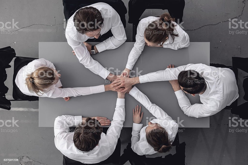 Business people joining hands stock photo