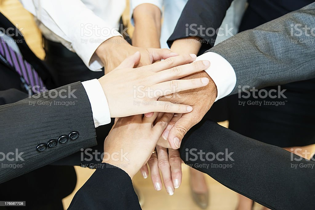 Business people joining their hands in agreement royalty-free stock photo