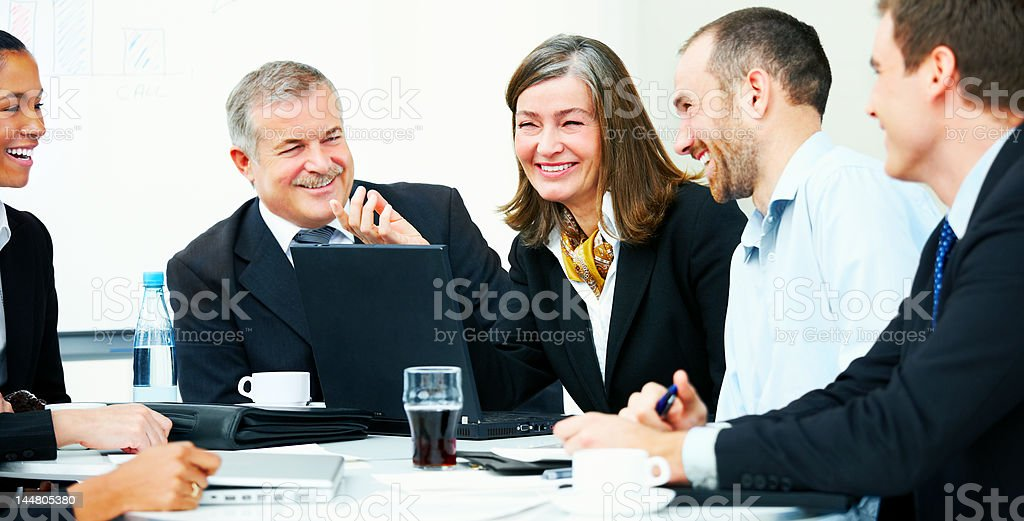 Business people laughing in a meeting royalty-free stock photo