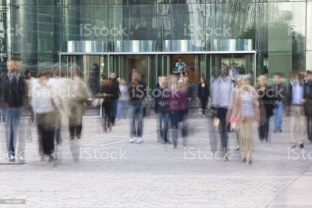 Business People Leaving Office Building, Blurred Motion stock photo