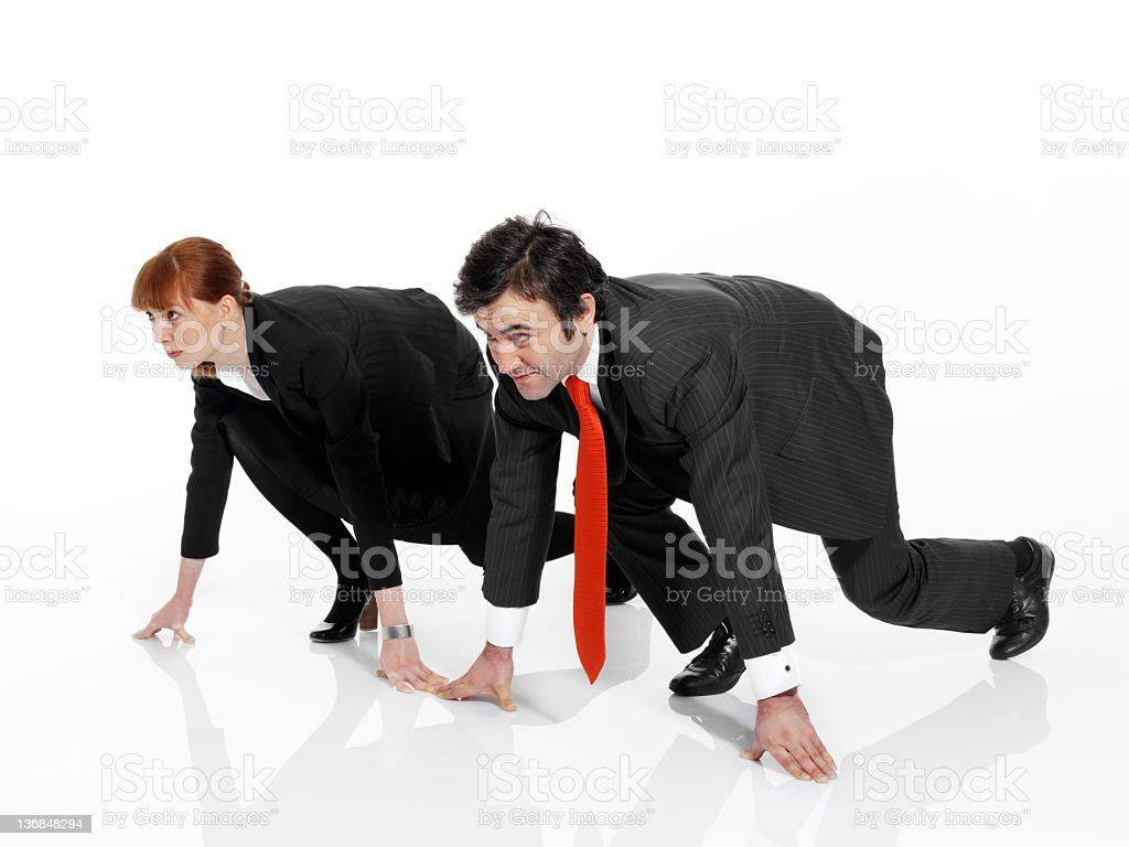 Business people line up in a starting to race royalty-free stock photo