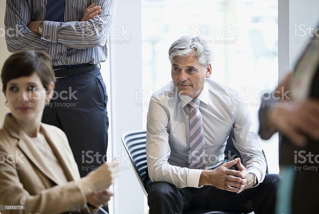 Business people listening in meeting royalty-free stock photo