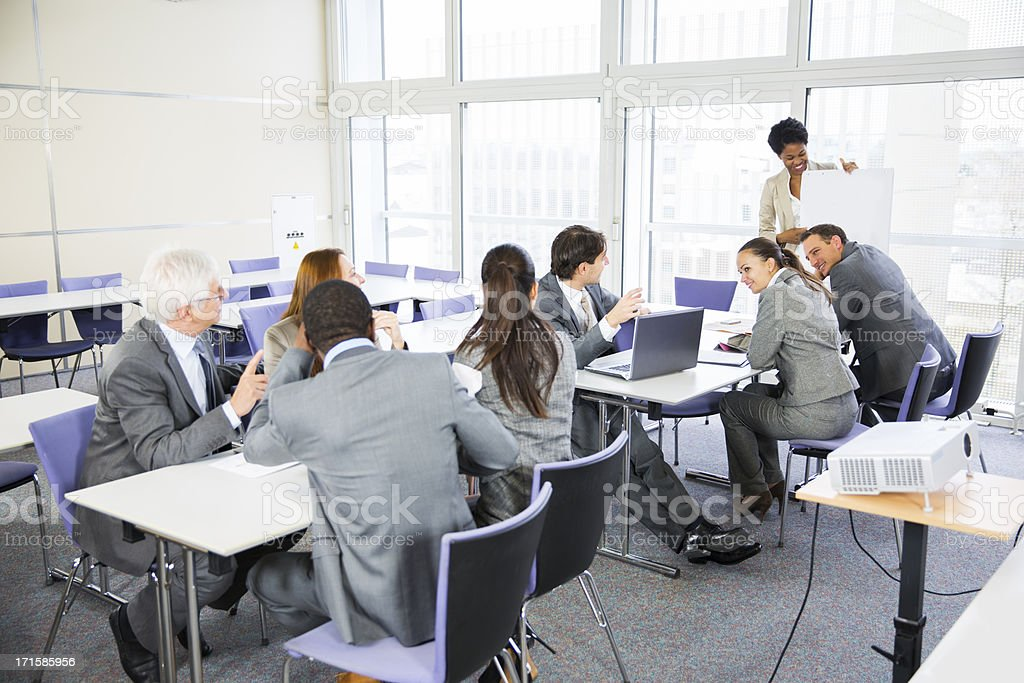 Business people listening lecture of a black teacher royalty-free stock photo