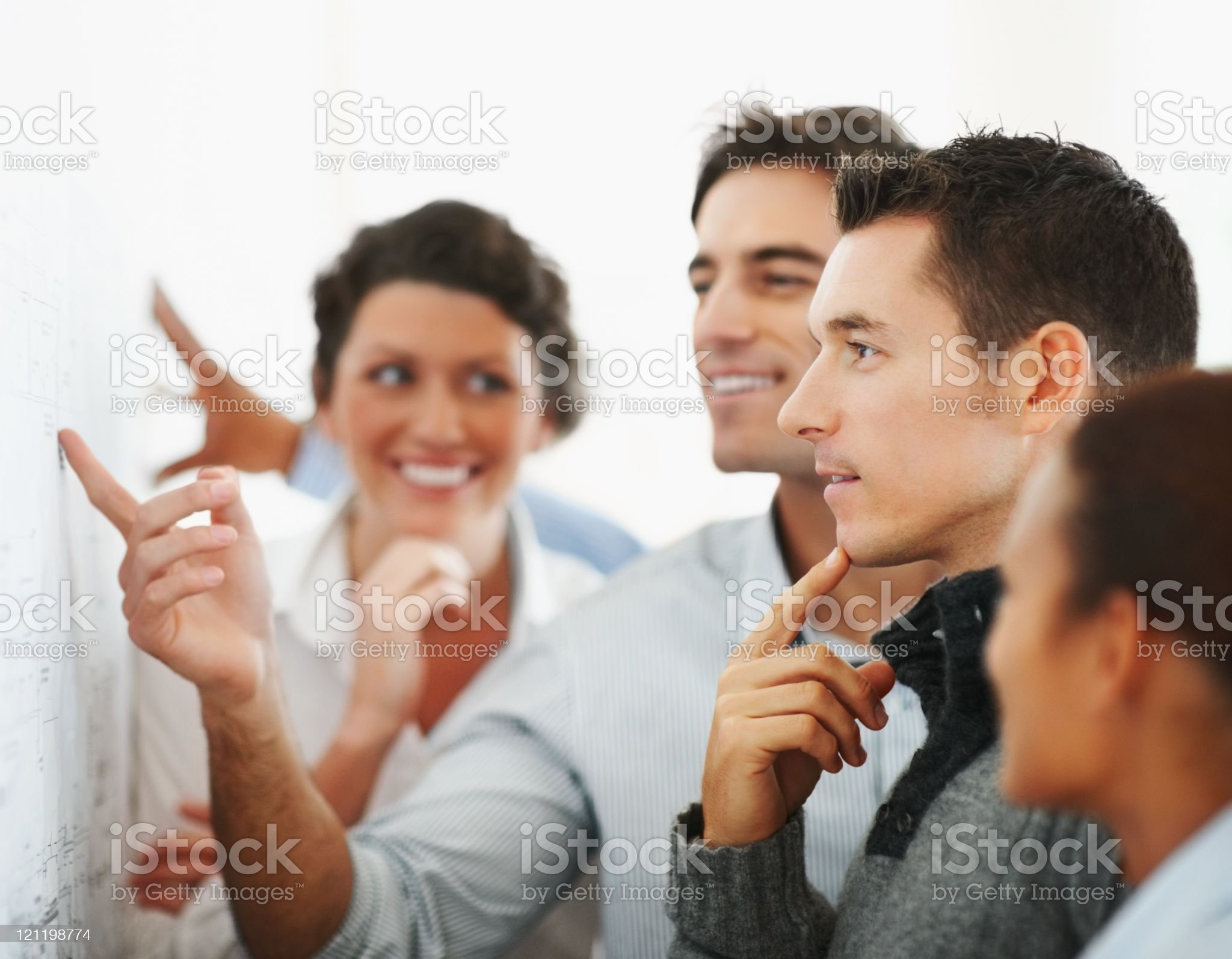Business people looking at a chart put on the wall royalty-free stock photo