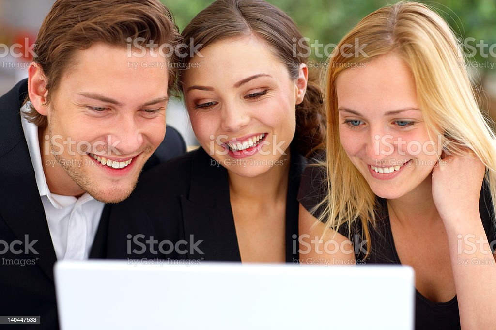 Business people looking at a laptop royalty-free stock photo