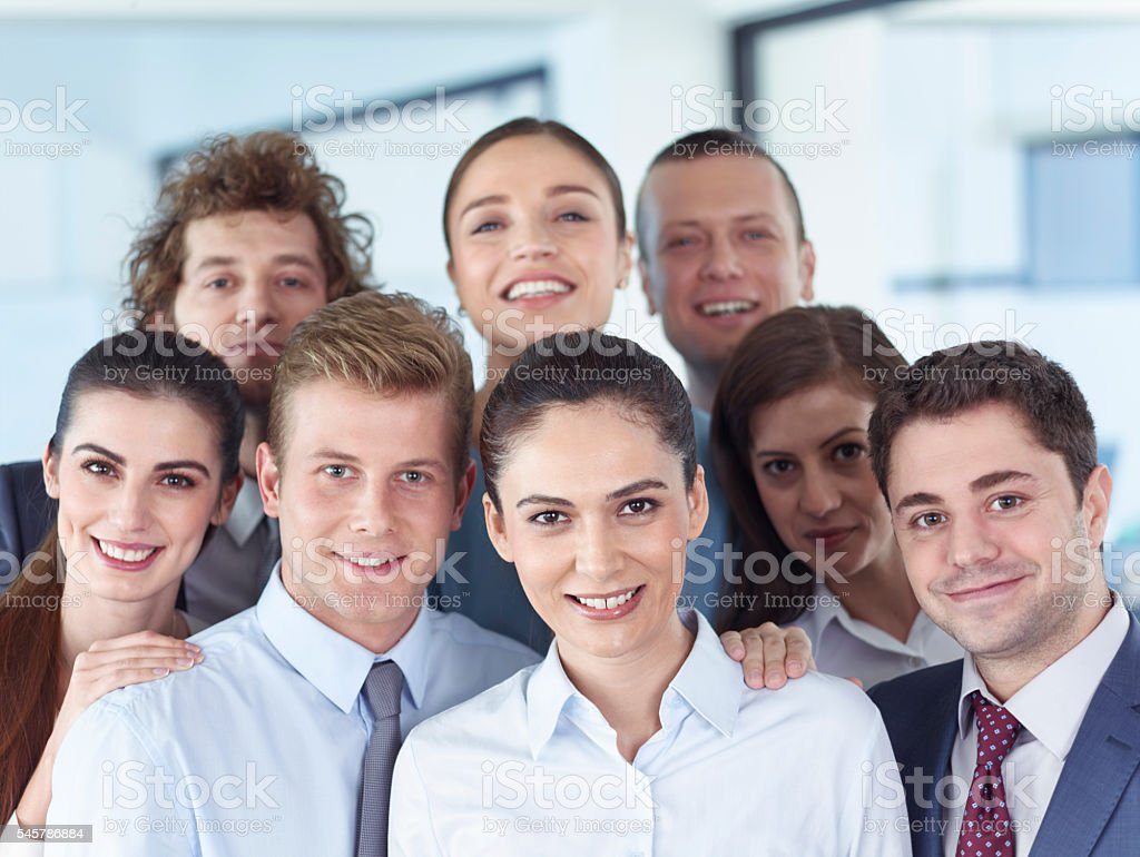 Business people looking at camera stock photo