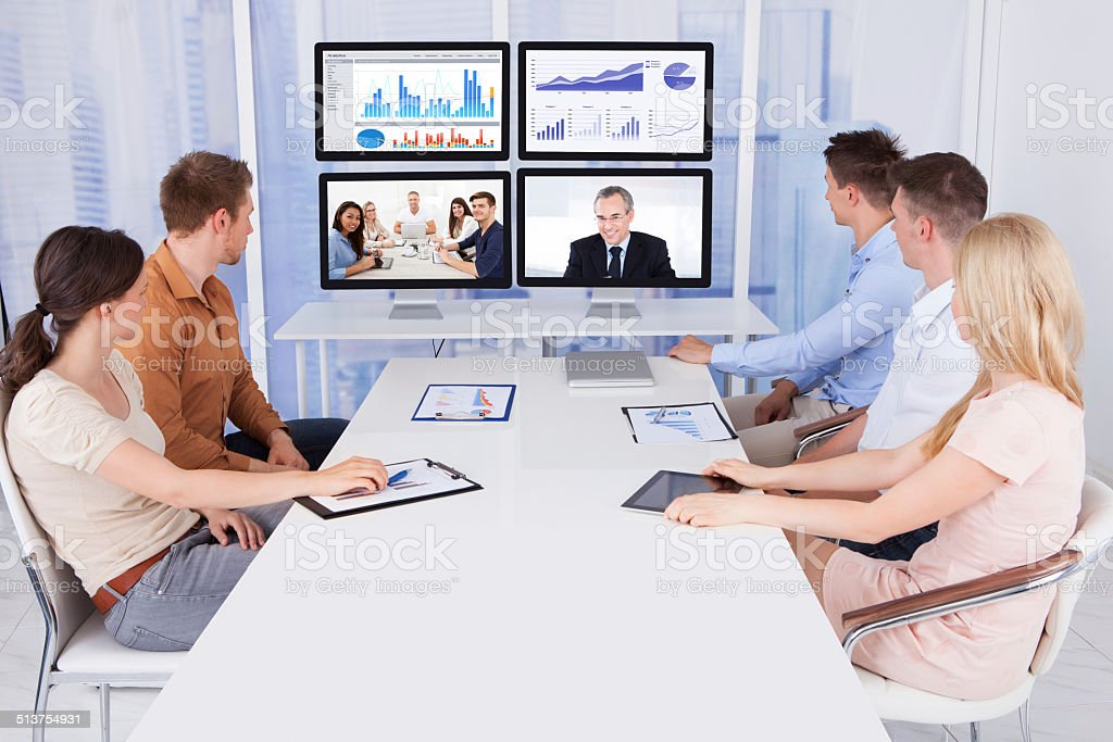 Business People Looking At Computer Monitors In Office stock photo