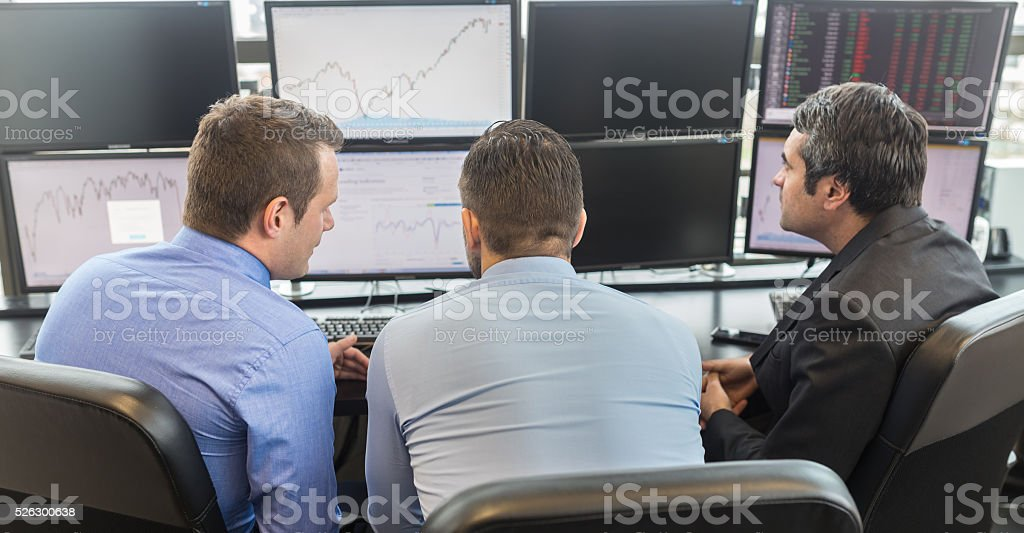 Business people looking at computer screens. stock photo