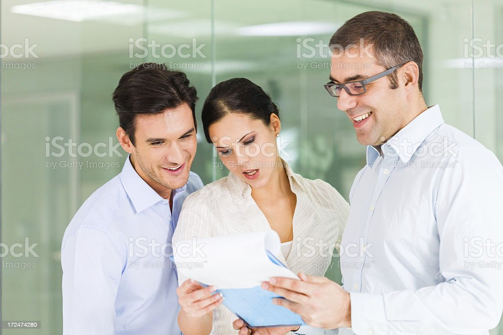 Business people looking at document royalty-free stock photo