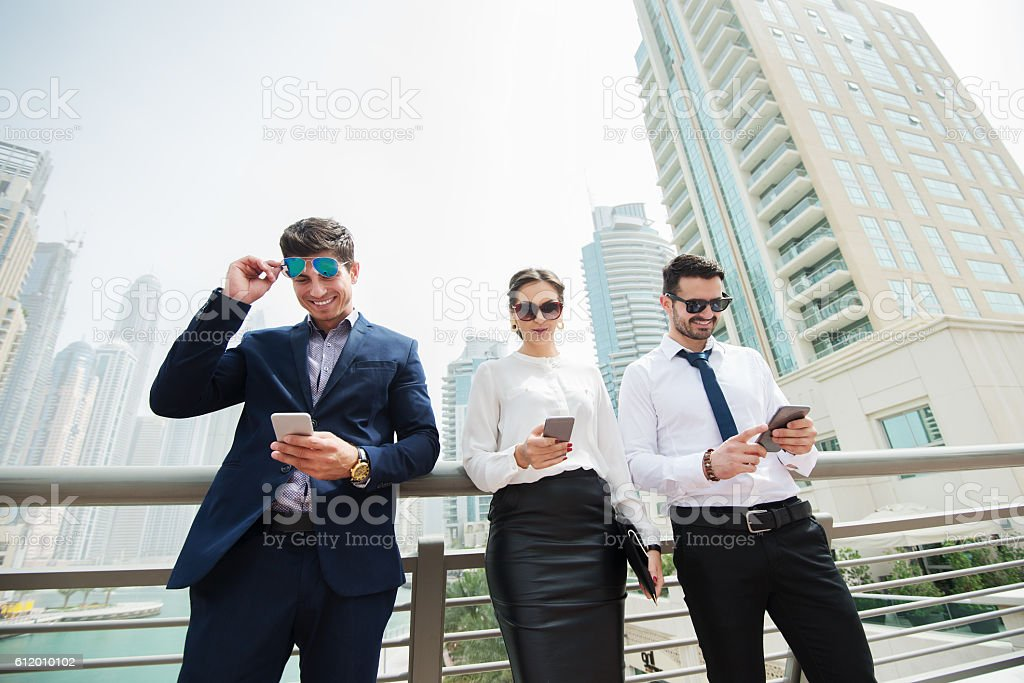 Business people looking at their smart phones. stock photo