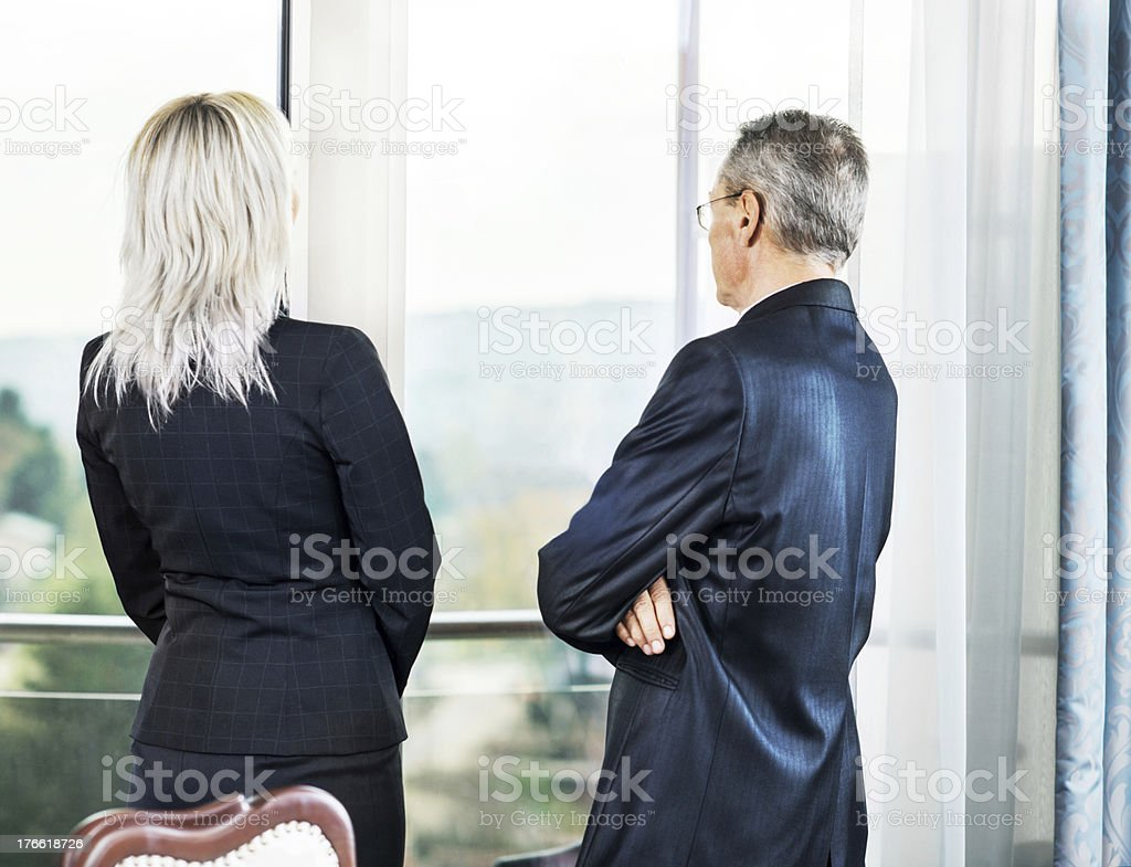 Business people looking through window. royalty-free stock photo