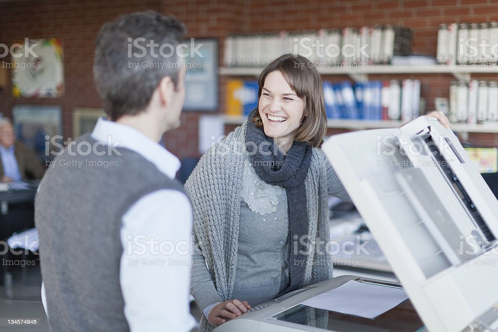 Business people making copies at work stock photo