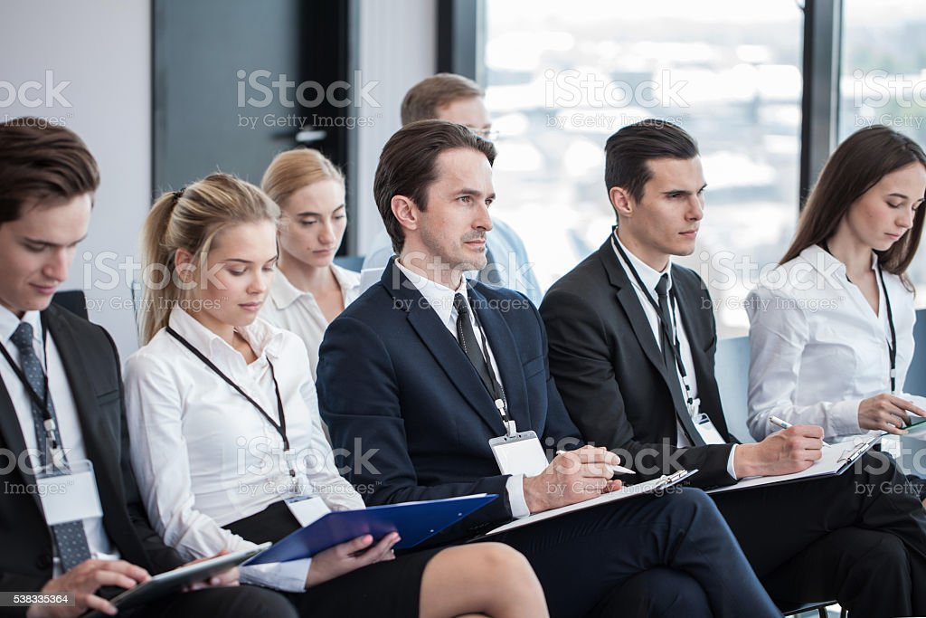 Business people making notes stock photo