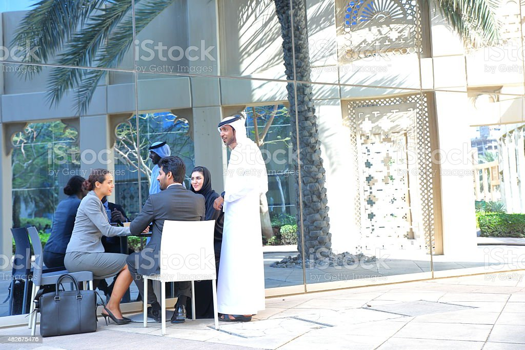 Business people meet outdoors in Dubai stock photo