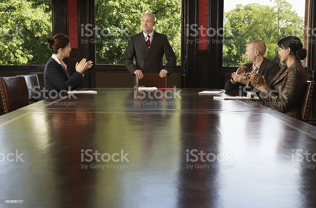 Business People Meeting Around Boardroom Table stock photo