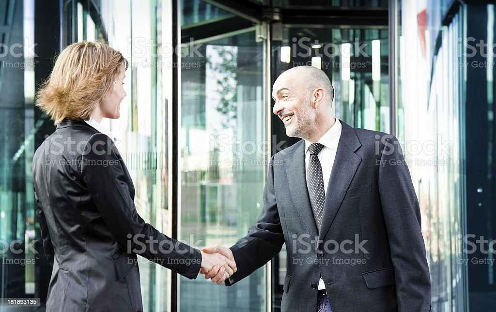 Business people meeting at a building entrance royalty-free stock photo