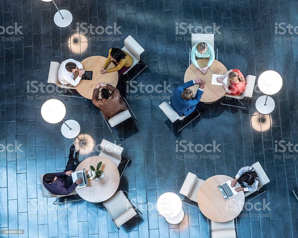 Business people meeting at tables, view from above stock photo