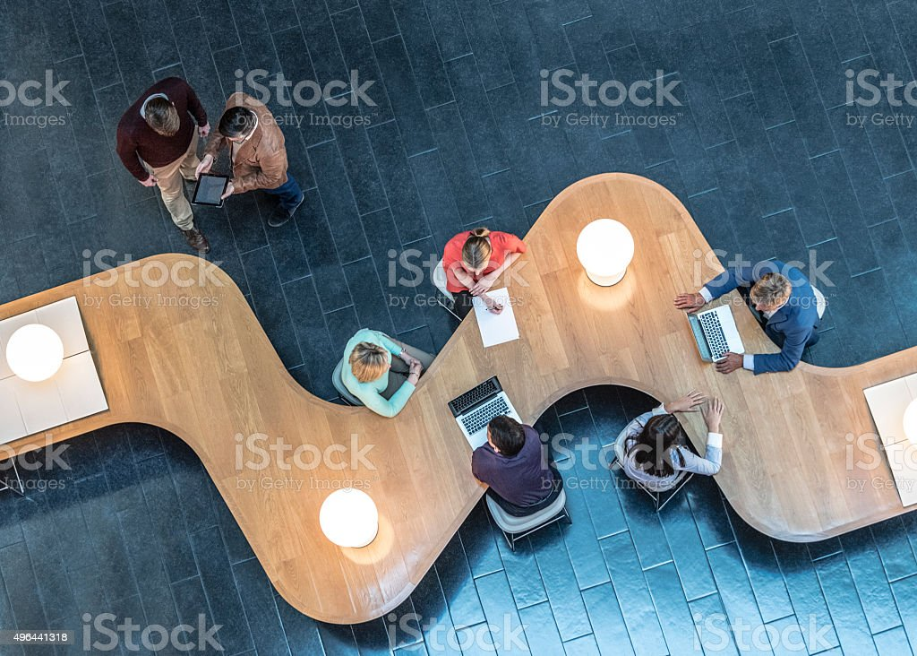 Business people meeting in modern office, view from above stock photo