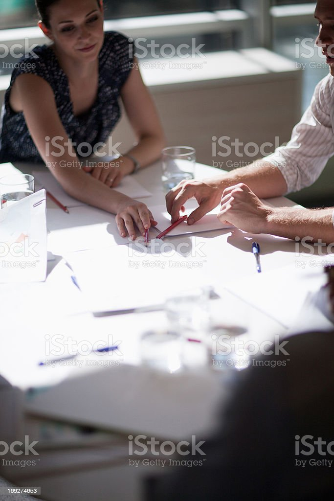 Business people meeting in sunny conference room stock photo