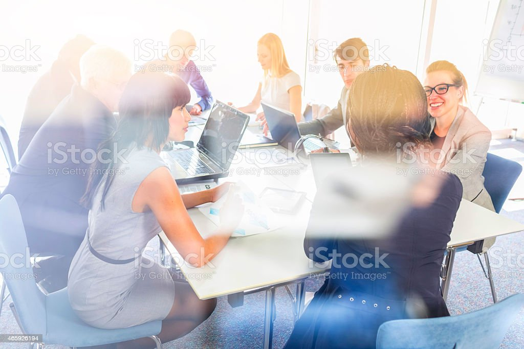 Business people, meeting, planning, reflection stock photo