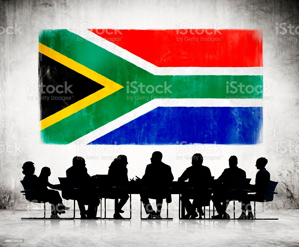 Business People Meeting With The National Flag Of South Africa stock photo