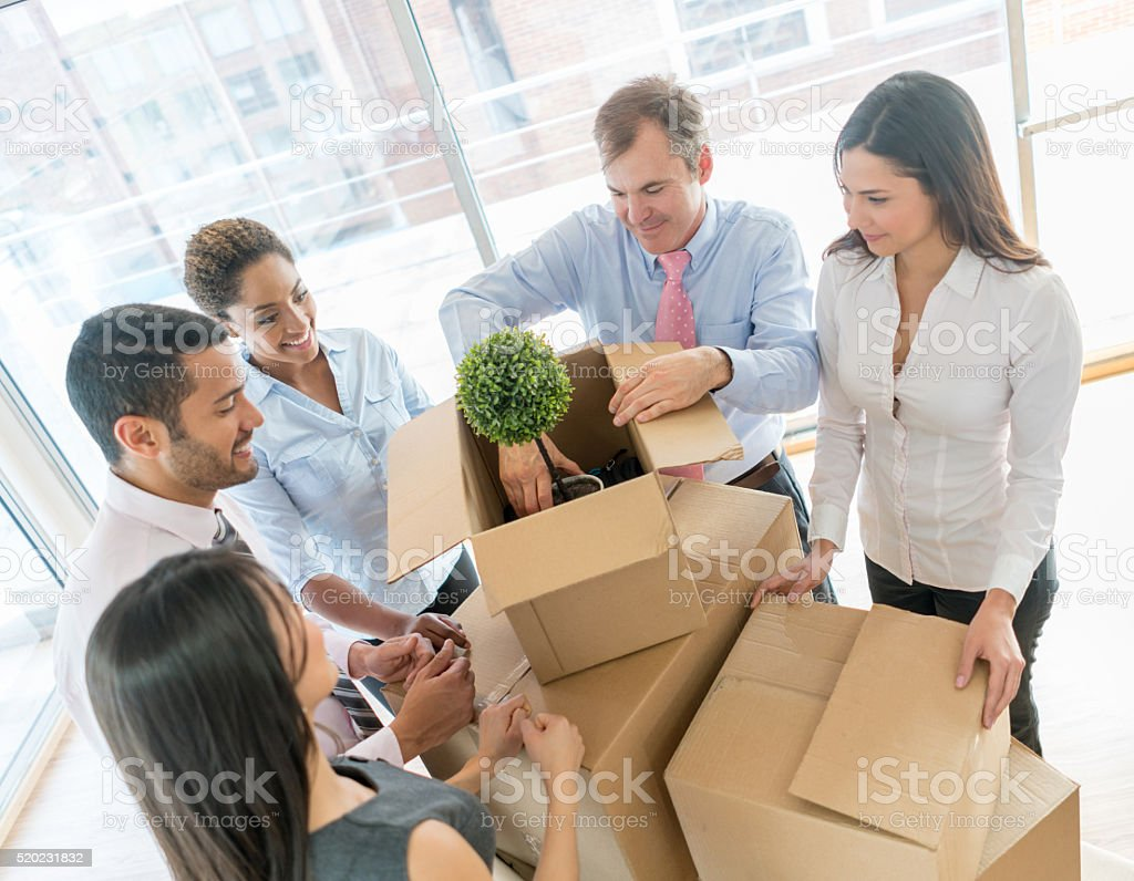 Business people moving and packing in boxes stock photo