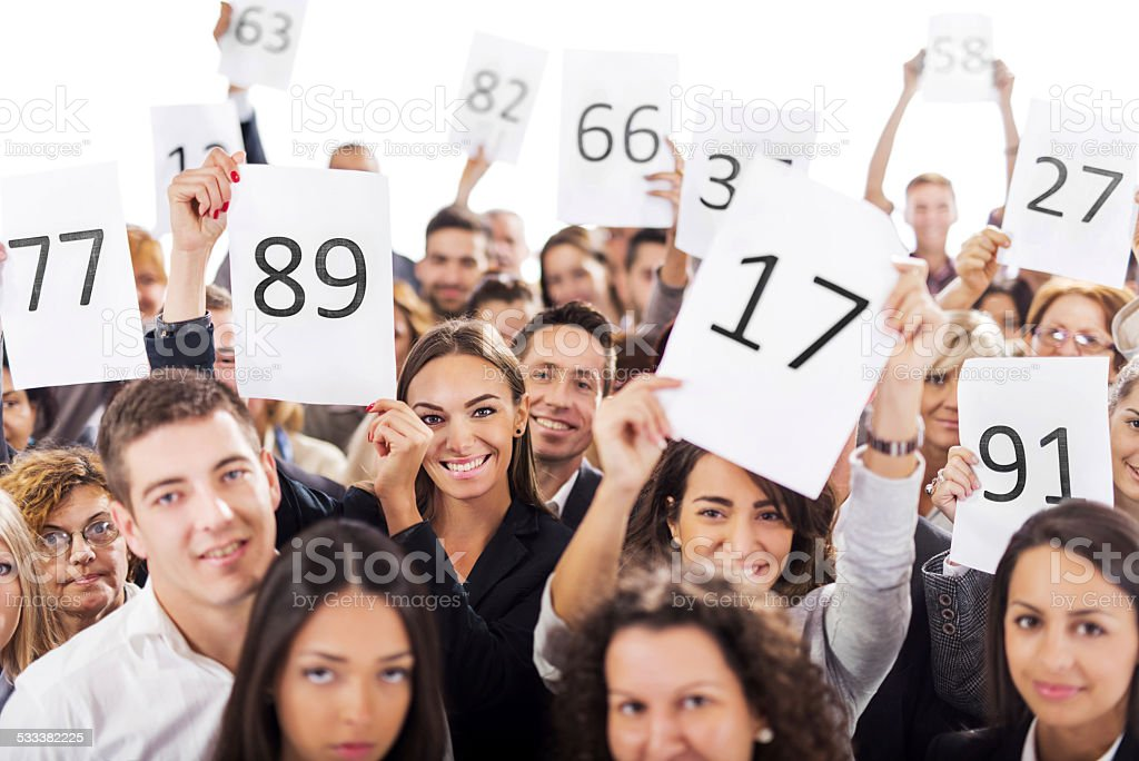 Business people on auction. stock photo