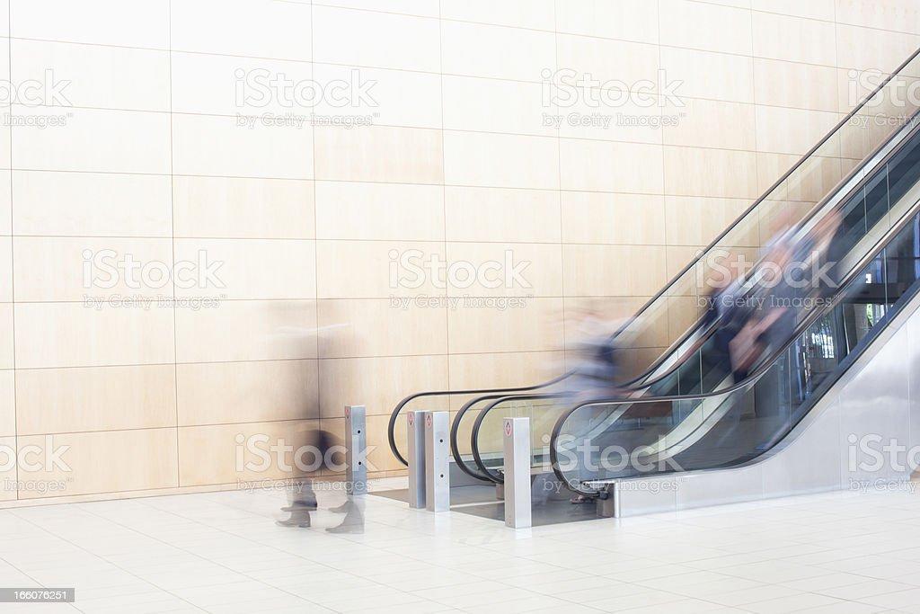 Business people on escalators royalty-free stock photo
