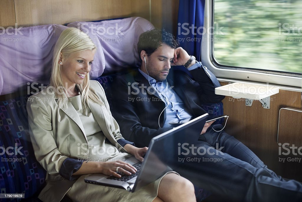 business people  on  passenger train using laptop and  digital tablet royalty-free stock photo