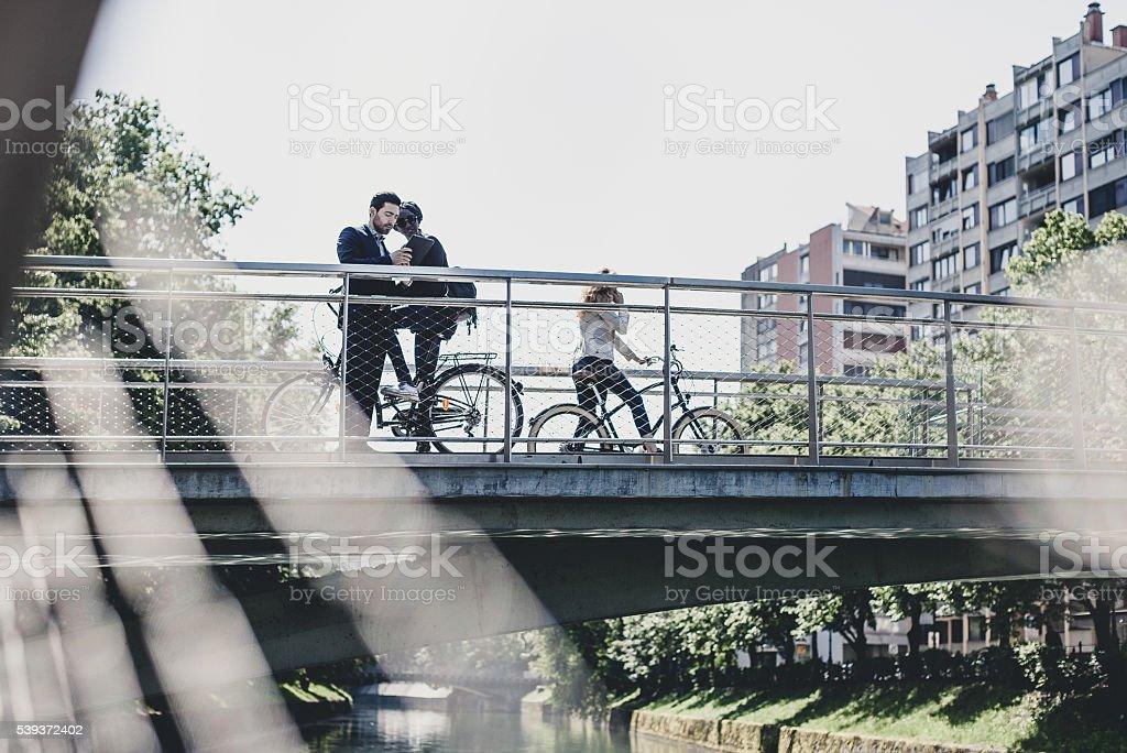 Business people on the bridge stock photo