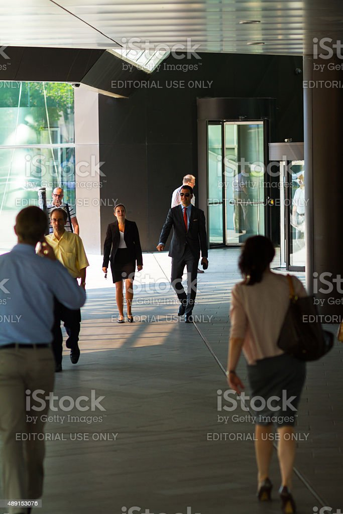Business people outside of Deutsche Bank stock photo