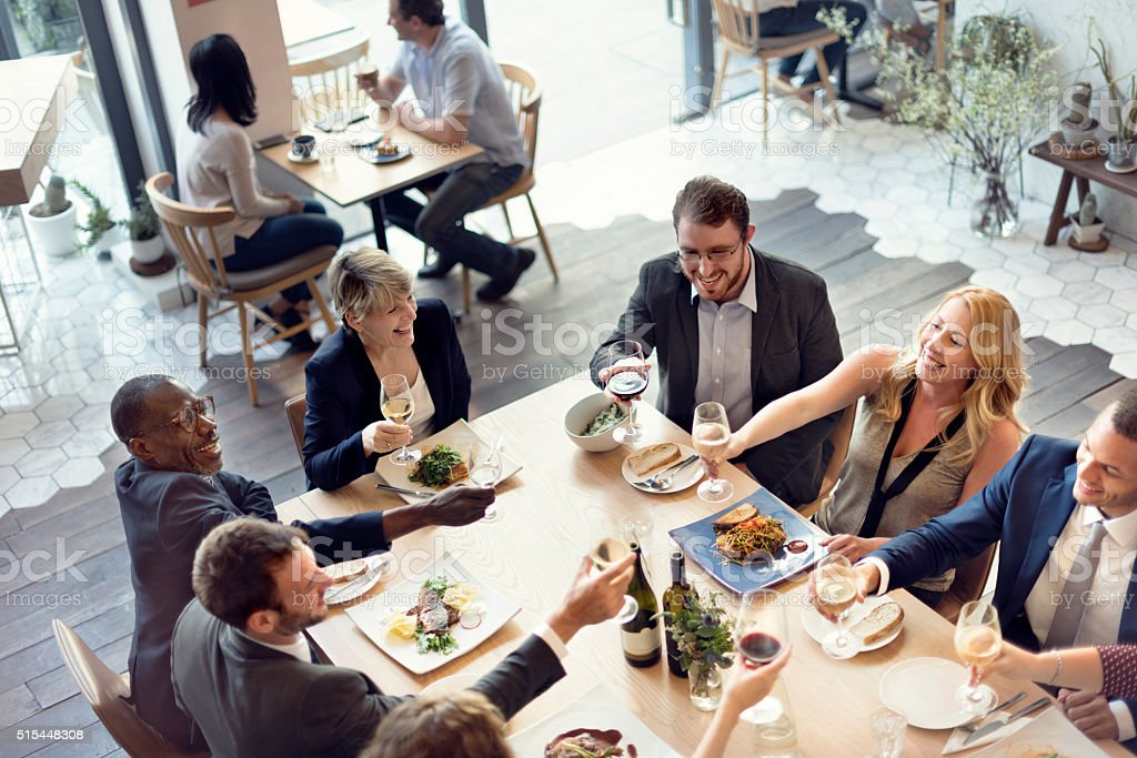 Business People Party Cheers Enjoying Food Concept stock photo