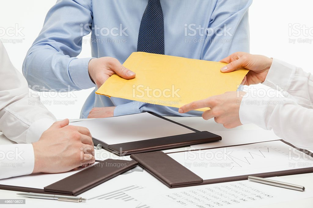 Business people passing an yellow envelope stock photo