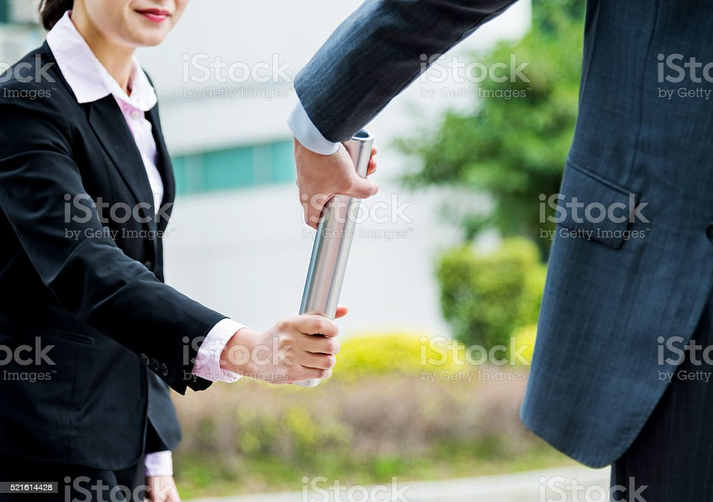 Business people passing baton stock photo