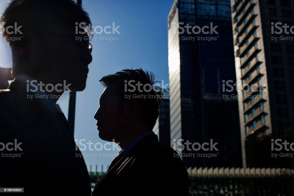Business people passing each other on the street downtown stock photo