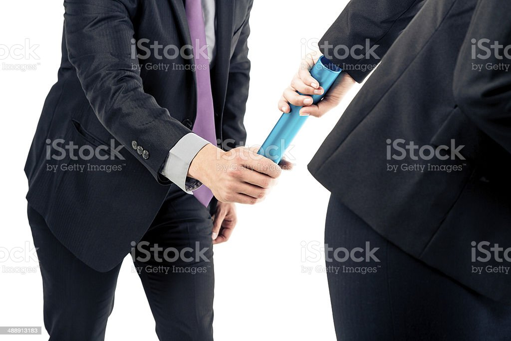 business people passing relay baton stock photo