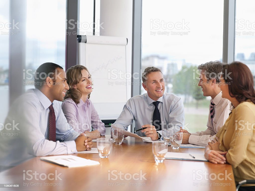 Business people planning together in a board room stock photo