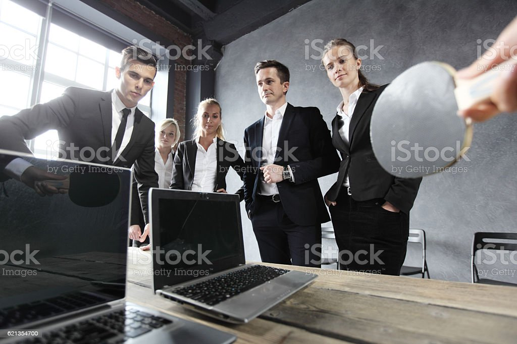 Business people play ping pong stock photo