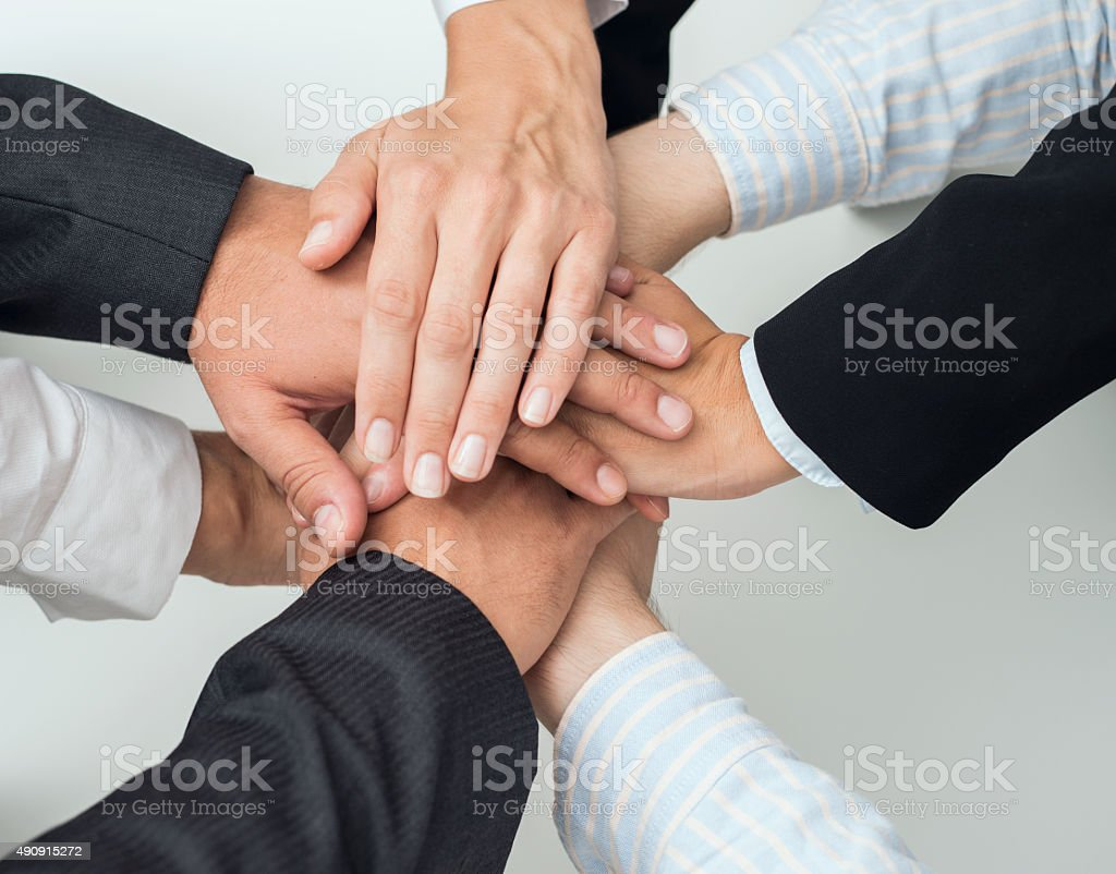 Business people putting hands together stock photo
